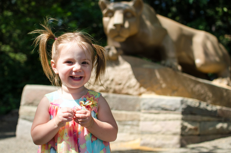 Two year old with the Lion Shrine at PSU