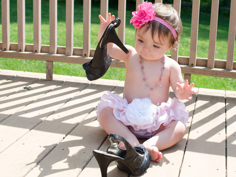One year old portrait with tutus and high heels.