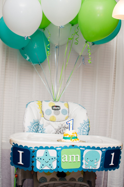 Birthday Boy's High Chair with Cake and Balloons