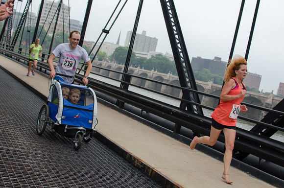Barefoot woman runs the Pasta 5K run 2014