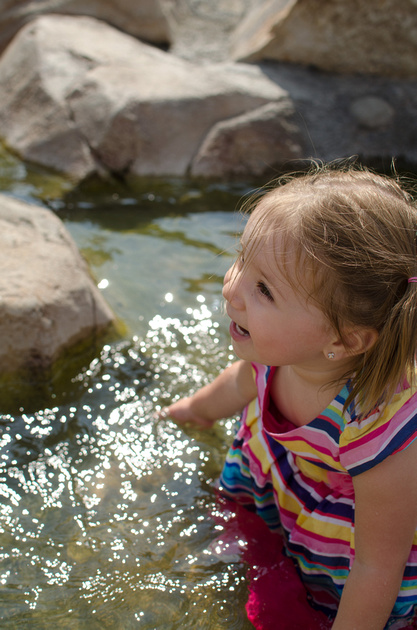 Little girl playing in the creek