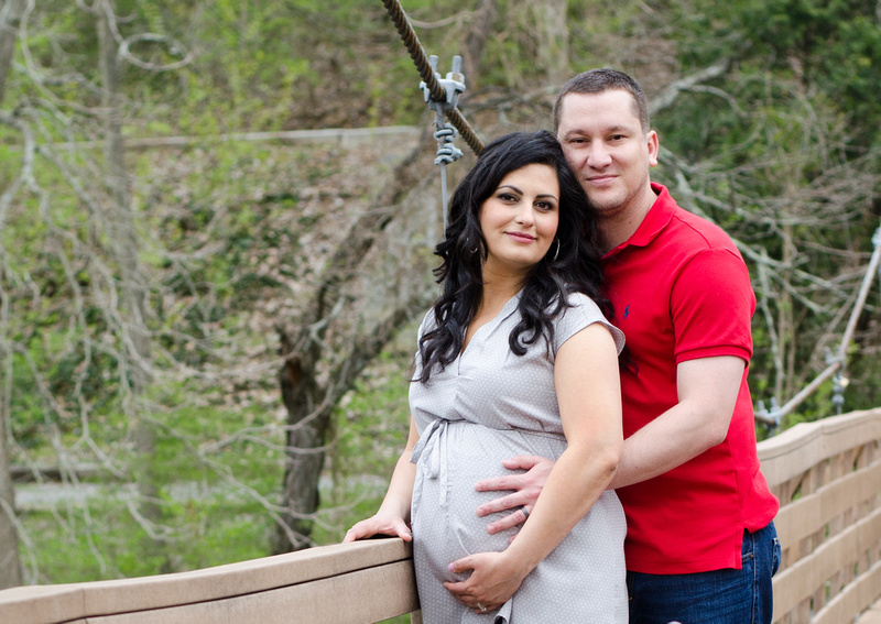 Husband and Pregnant Wife Portrait on a suspended bridge