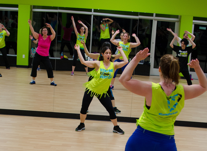 The ladies of Zumba dancing to the beat.