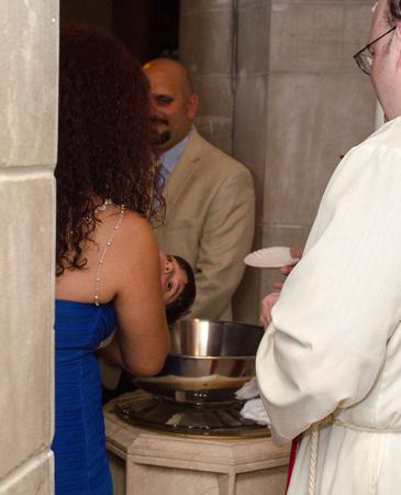 Little boy is getting baptized.