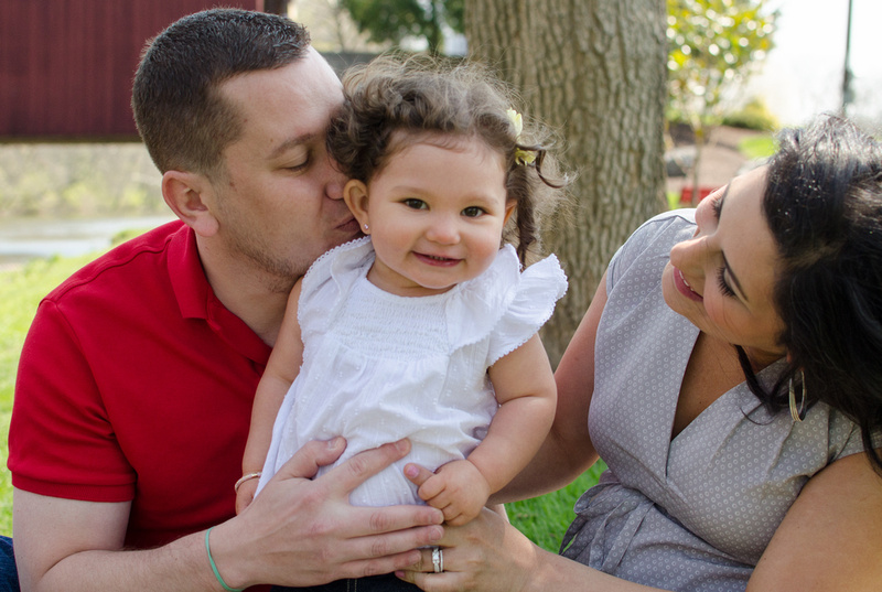 Outdoor family portrait with a one year old girl