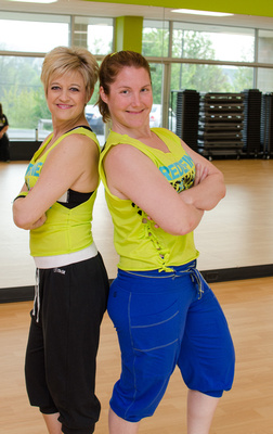 Two Zumba Instructors standing back to back in the studio.