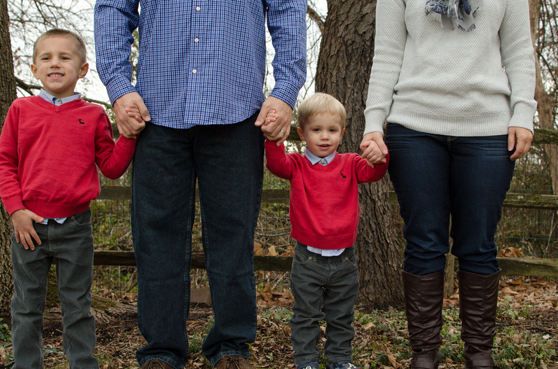 Family of Four Holds Hands Portrait Pose