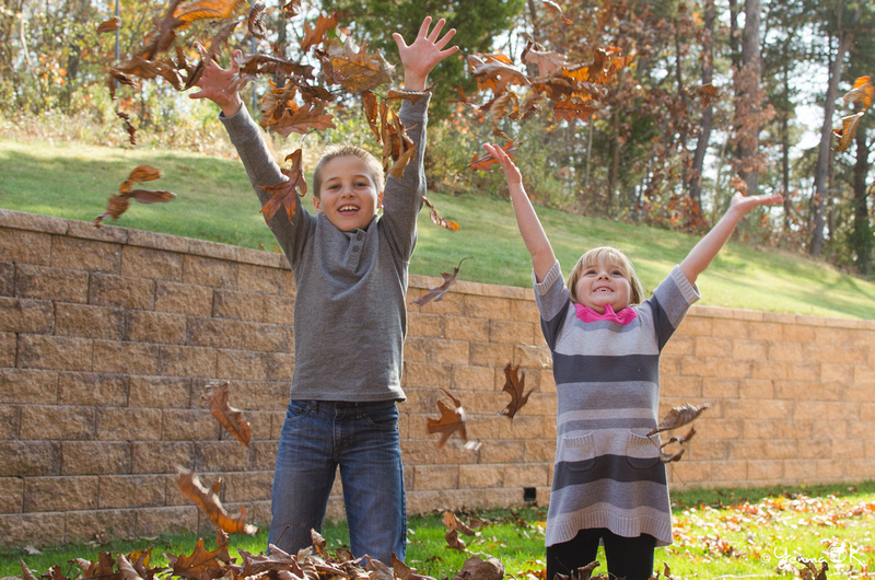 Sibling Portrait of Kids throwing leaves
