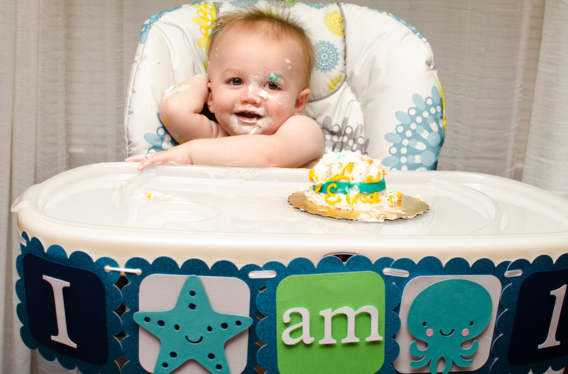 One Year Smiles While Eating Cake