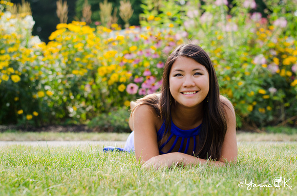 Outdoor Senior Portrait Pose in a Garden